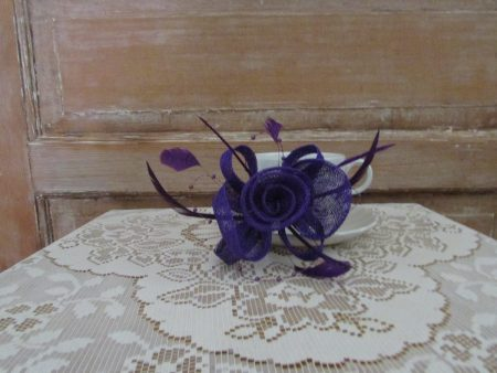 Sinamay fascinator in purple