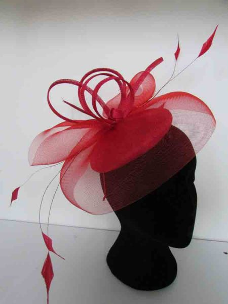 Sinamay topped with crin swirls and loops with diamond shaped feathers on an aliceband in red