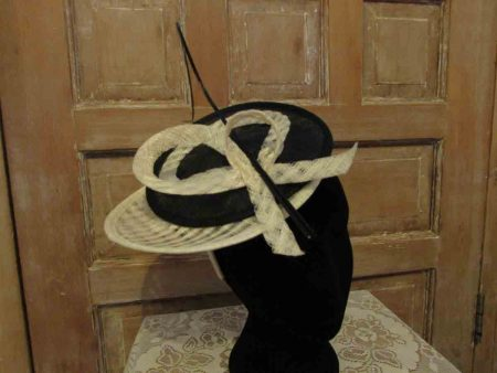 Sinamay disc looped fascinator in black and cream
