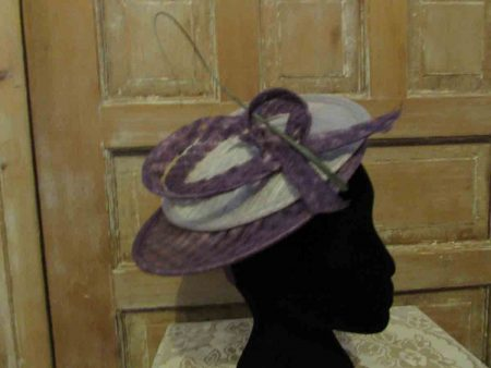 Sinamay disc looped fascinator in Silver and purple