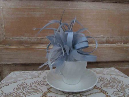 Feather flower fascinator in silver