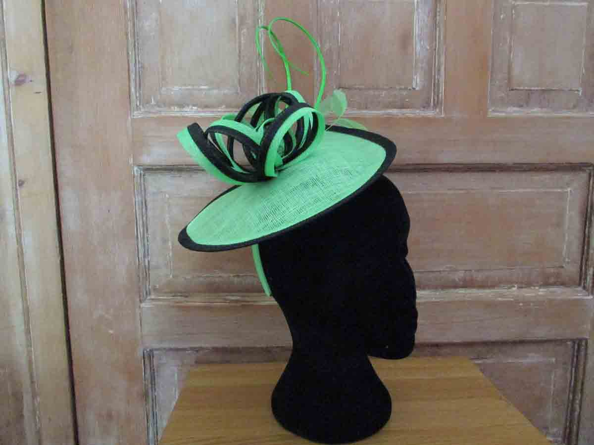 Sinamay fascinator in lime and black