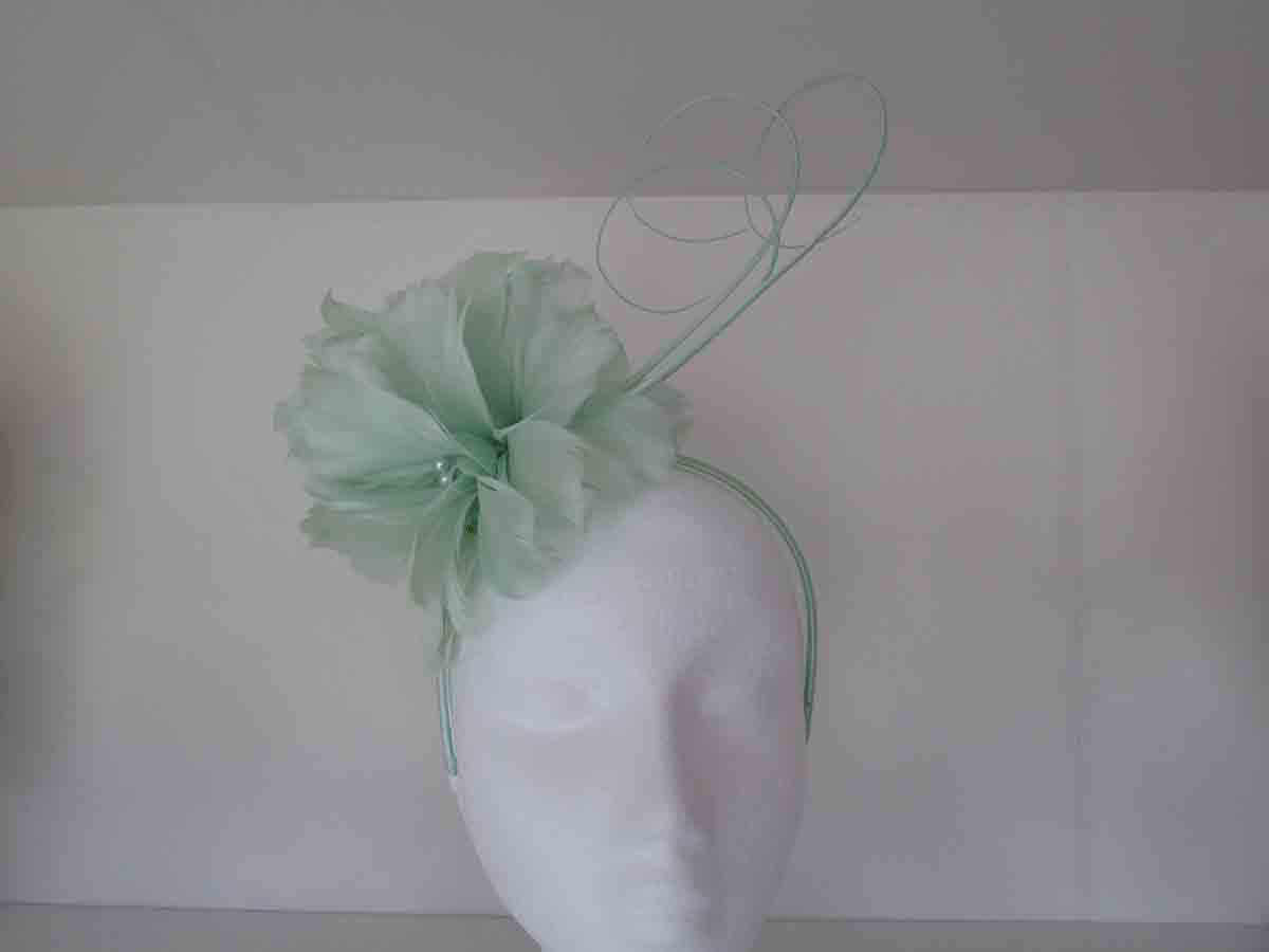 Floral fascinator with quills in mint