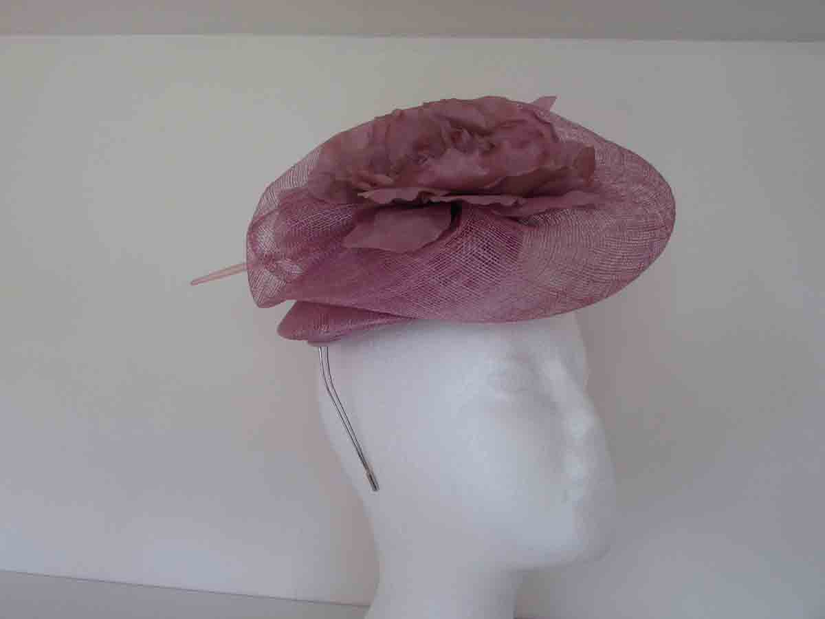 Sinamay fascinator with large flower in light pink