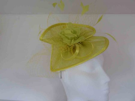 Twisted sinamay fascinator in yellow