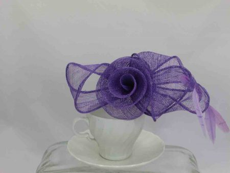 Sinamay bow with flower in centre purple