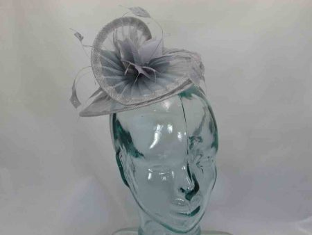 Swirl netted fascinator with feathered flower in silver