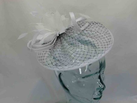 Sinamay fascinator with black netted detail in white