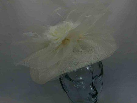 Wavy fascinator with centre flower in cream