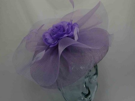 Wavy fascinator with centre flower in lavender