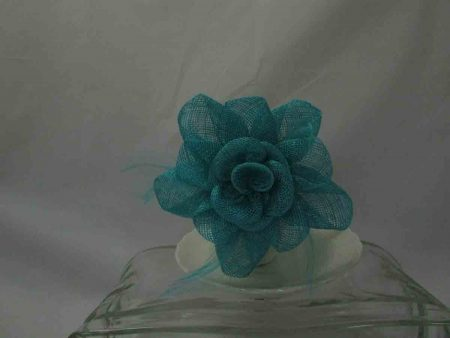 Sinamay flower fascinator in aqua green