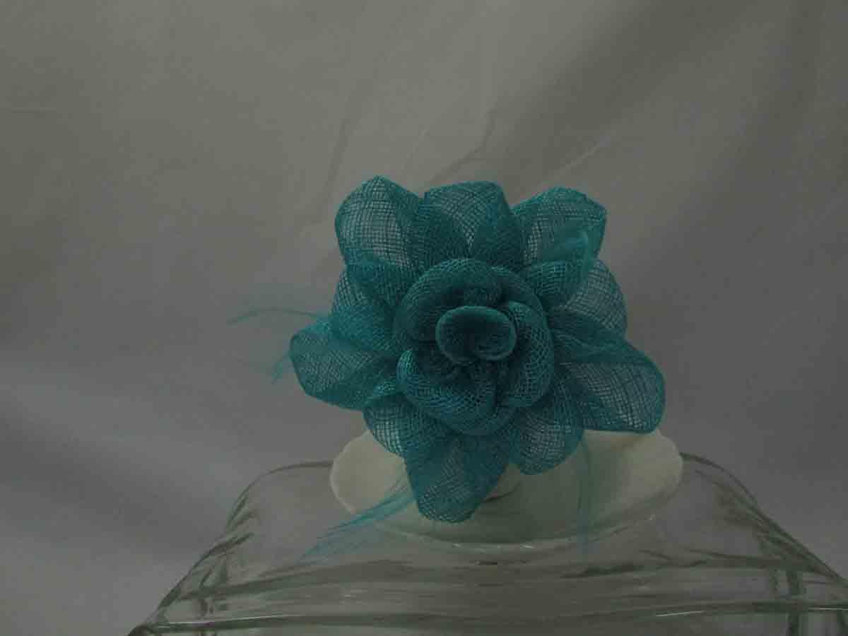 3154577bfaf Sinamay flower fascinator in aqua green. Home / Blues / Sinamay flower  fascinator in aqua green ...