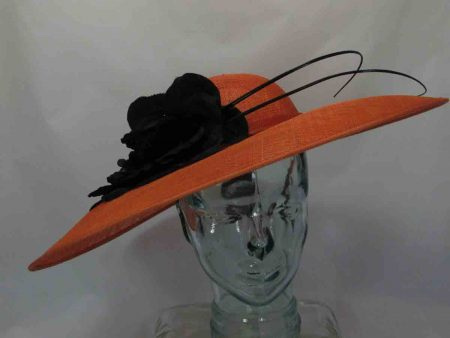 Large sinamay hatinator in orange with black flower