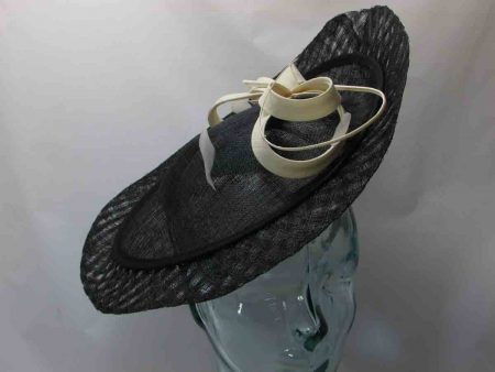 Sinamay hatinator in black with cream bow detail and quill