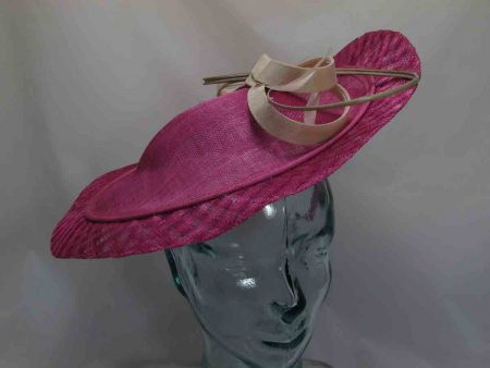 Sinamay hatinator in pink with cream bow detail and quill