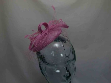 Pillbox  fascinator with netted detail in pink