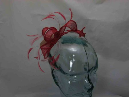 Looped fascinator in brick red