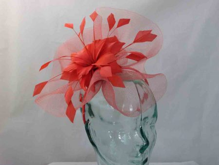 Crin fascinator with feathered flower in burnt orange