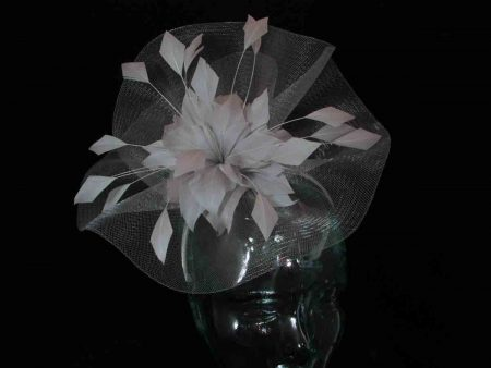 Crin fascinator with feathered flower in silver