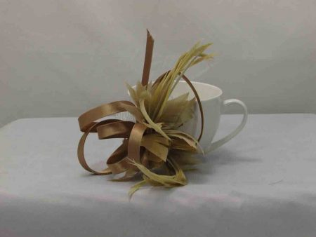 Feather flower fascinator deep gold