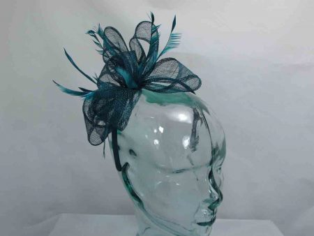 Sinamay looped fascinator in teal