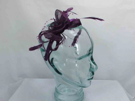 Sinamay and beading fascinator in purple