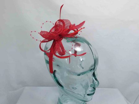Sinamay and beading fascinator in red