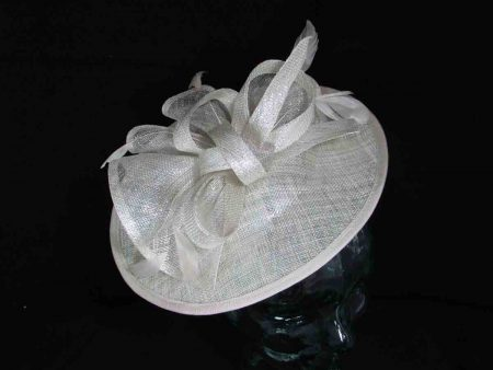 Medium sinamay fascinator in ivory with a silver lurex thread