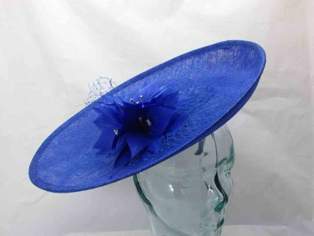 Sinamay hatinator with feathered flower in cobalt