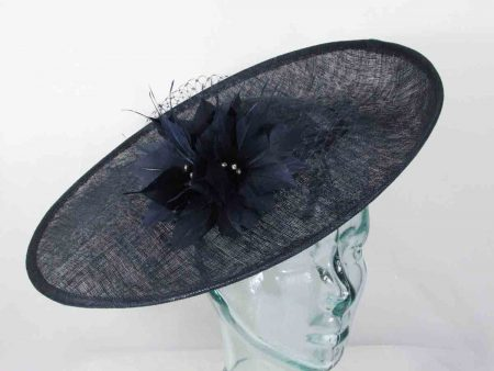 Sinamay hatinator with feathered flower in navy
