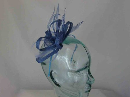 Sinamay fascinator with flower in light blue