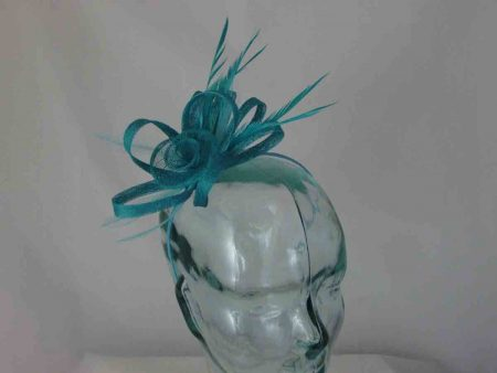 Sinamay fascinator with flower in turqouise