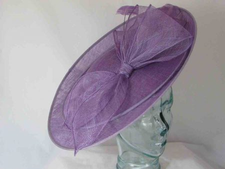 Large hatinator with sinamay bow in wisteria