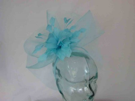 Crin fascinator with feathered flower in aqua blue
