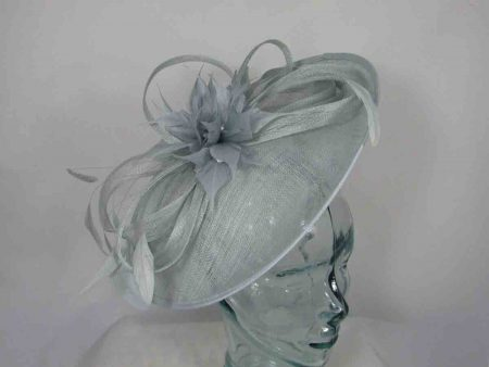 Sinamay hatinator with feathered flower in cloud silver