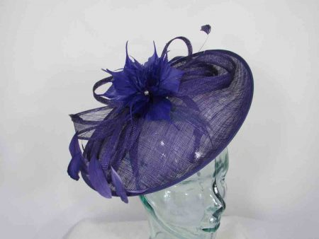Sinamay hatinator with feathered flower in imperial purple