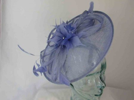 Sinamay hatinator with feathered flower in sky blue