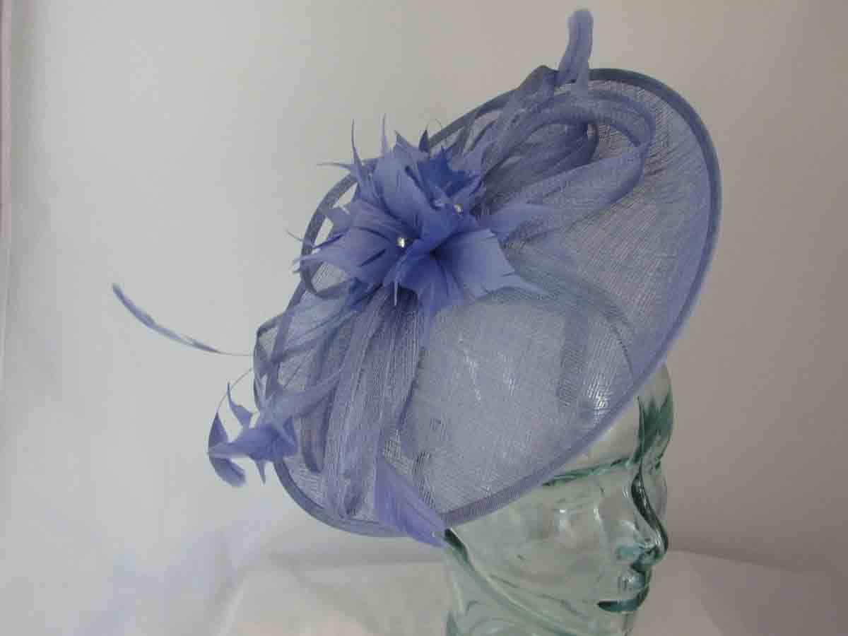 a3b3d9b2 Sinamay hatinator with feathered flower in sky blue - Love Fascinators