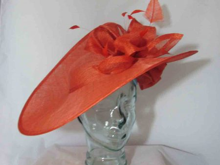 Three quarter brim hatinator with dramatic sinamay detail, feathers and underflower in orange