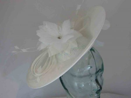 Dramatic sinamay hatinator with under flower in ivory