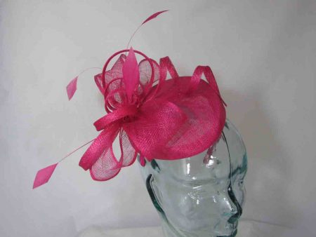 Pillbox with sinamay bow in hot pink