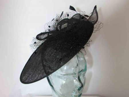 Circular hatinator with sinamay bow in black