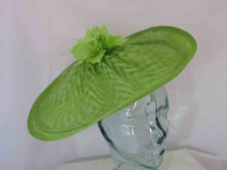 Double sinamay hatinator with flowered feather in lime
