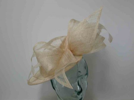 Three quarter brim sinamay hatinator with side bow in nude