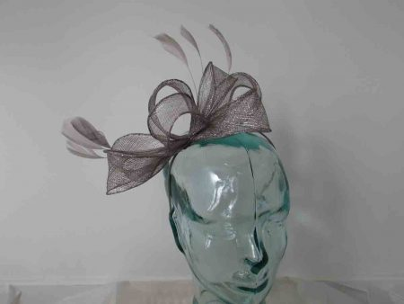 Looped sinamay fascinator in silver with a silver lurex thread