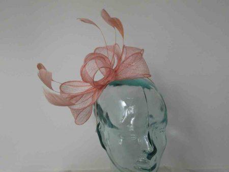 Looped sinamay fascinator in light pink
