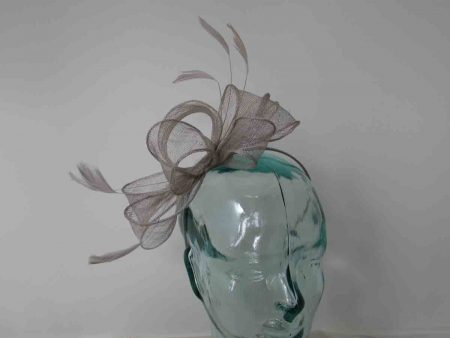 Looped sinamay fascinator in silver