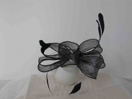 Looped sinamay fascinator in black with a silver lurex thread