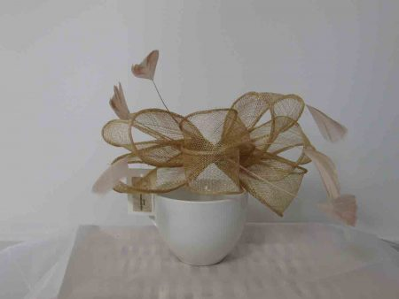 Looped sinamay fascinator in gold