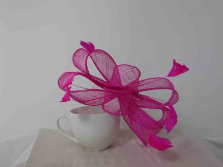 Looped sinamay fascinator in hot pink